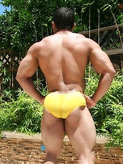 Bodybuilder Mike Morelli poses in and out of his jockstrap