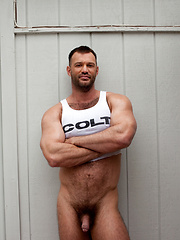 Hot muscled hunk shows cock
