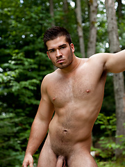 Big muscled man outdoors