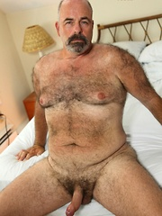 Furry bear Tony Thompson is sweating out the summer heat with strokin' his big uncut man meat