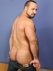 Sexy Rocky LaBarre has massive biceps, a furry chest and a huge rock-hard cock