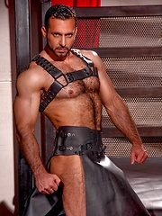 Adam Champ posing in leather skirt