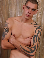 Tattooed twink shows his perfect body and uncut cock