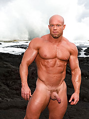 Muscled bald guy posing outdoor