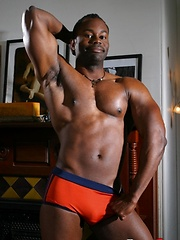 Black hung man shows his perfect body