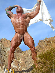 Bald bodybuilder showing his strong body