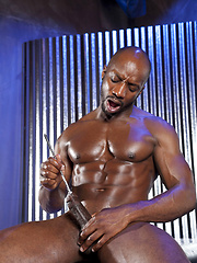 Ebony gay Race Cooper playing with his oiled dick and metal rod