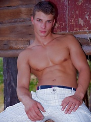 Beefy jock takes off his clothes in the wood