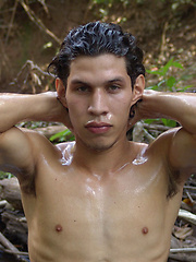 Ricardo sits down to jerk his uncut cock beside a stream